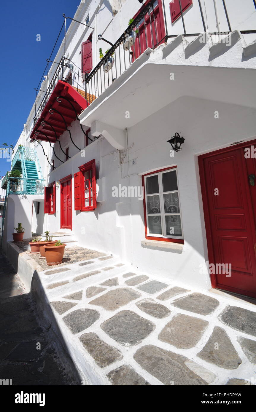 White House Red Doors And Windows Mykonos Greece Stock Photo