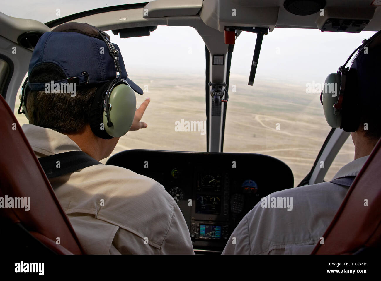 Pilots in helicopter cabin - Stock Image