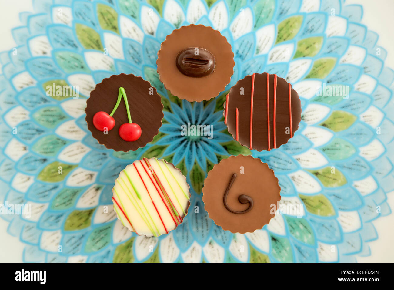 Multicolored chocolate assortments - Stock Image