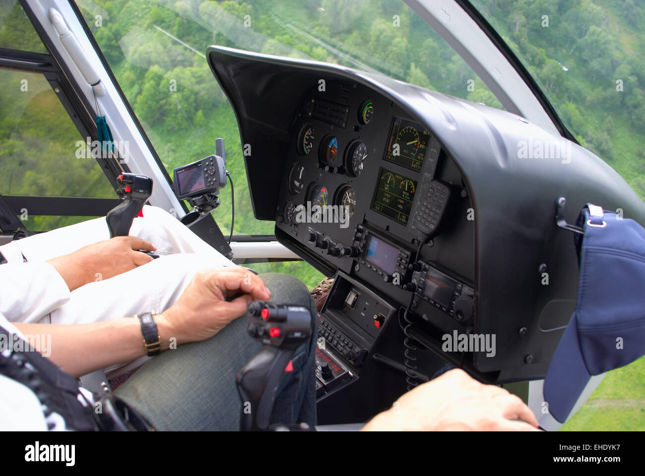 Pilots in helicopter cabin Stock Photo