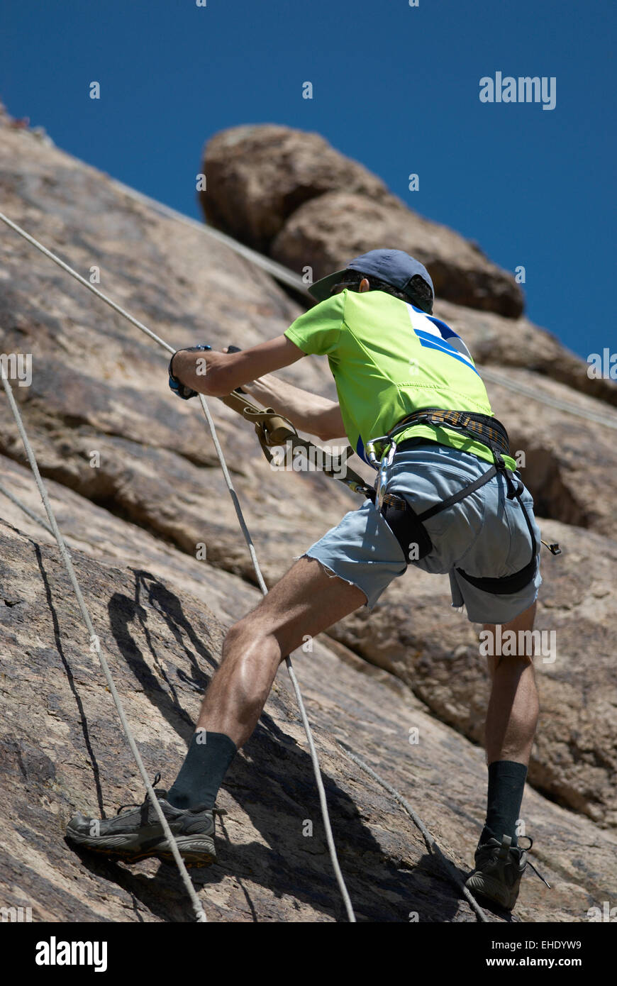 Clamber on cliff - Stock Image