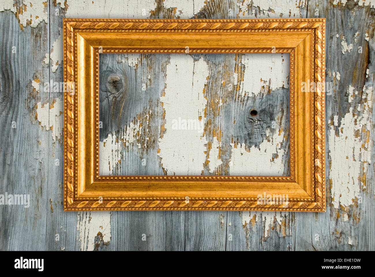 Gold frame on a old wooden wall background Stock Photo: 79599125 - Alamy