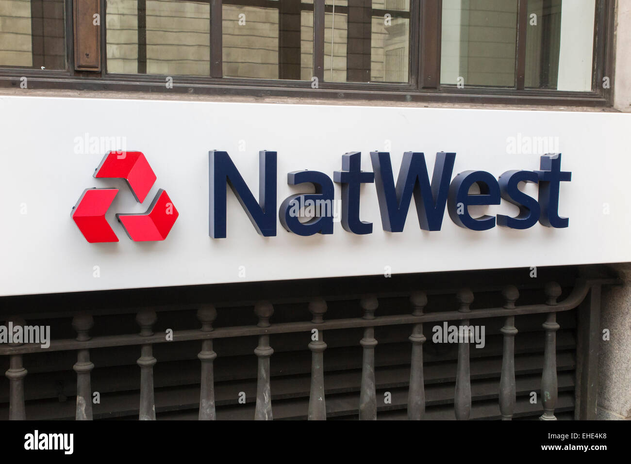 Retail banking::NatWest (National Westminster Bank) name and logo on an external wall outside the bank branch in - Stock Image