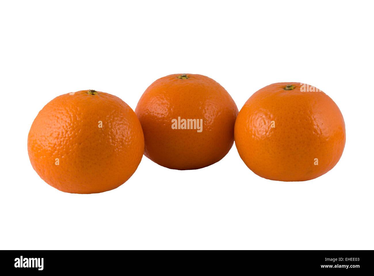 Three ripe oranges on a white background - Stock Image