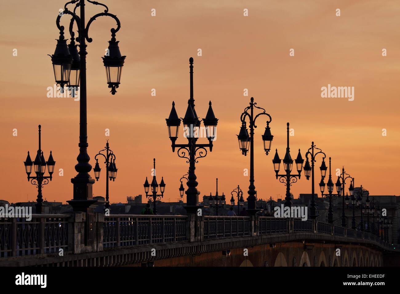 Lanterns over the bridge Pont de Pierre - Stock Image