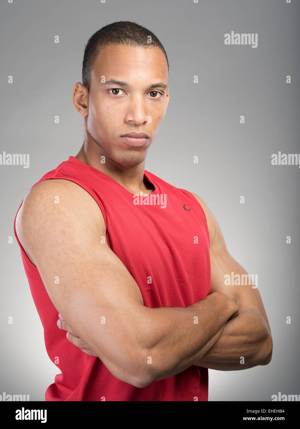 Muscular man wearing red tank top vest Stock Photo