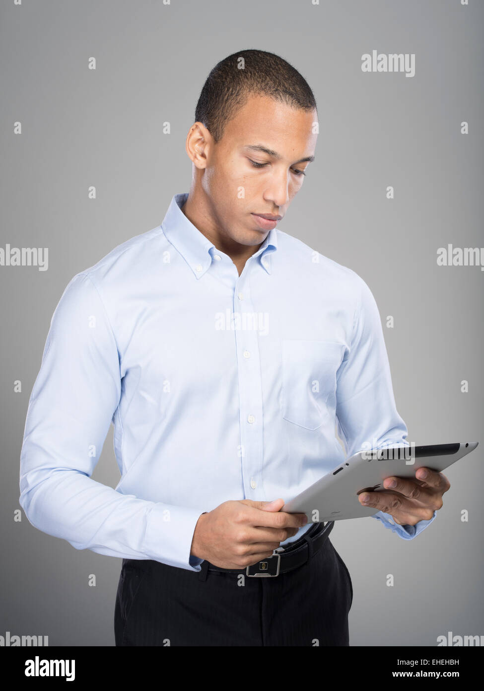 Man using Apple iPad tablet computer - Stock Image