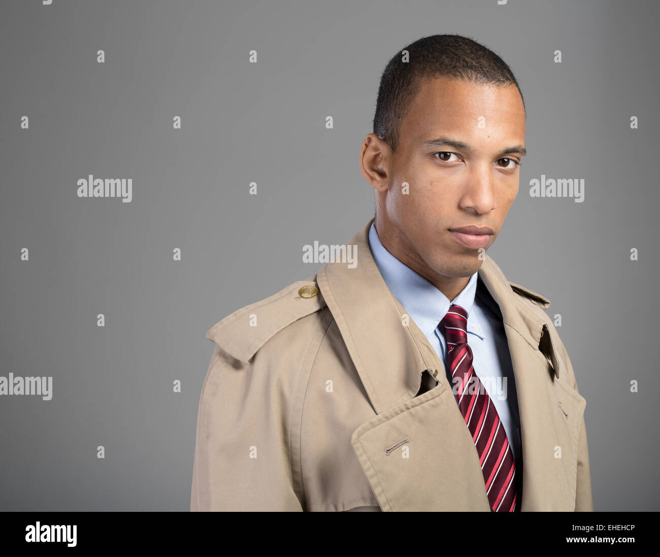 Businessman wearing suit tie and beige Burberry trench coat - Stock Image
