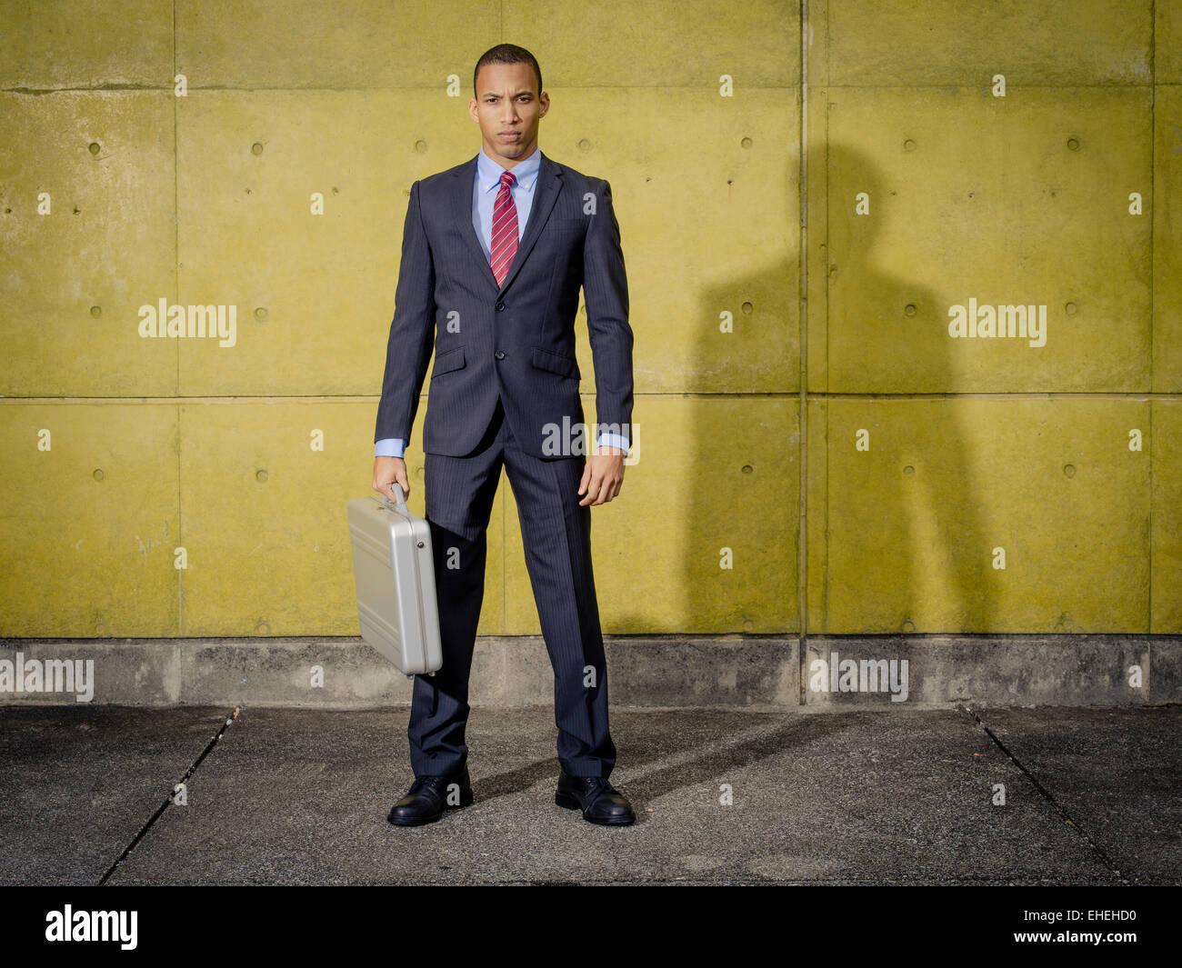 Businessman portrait wearing suit and tie with Halliburton Zero Aluminum Aluminium briefcase / attache case - Stock Image