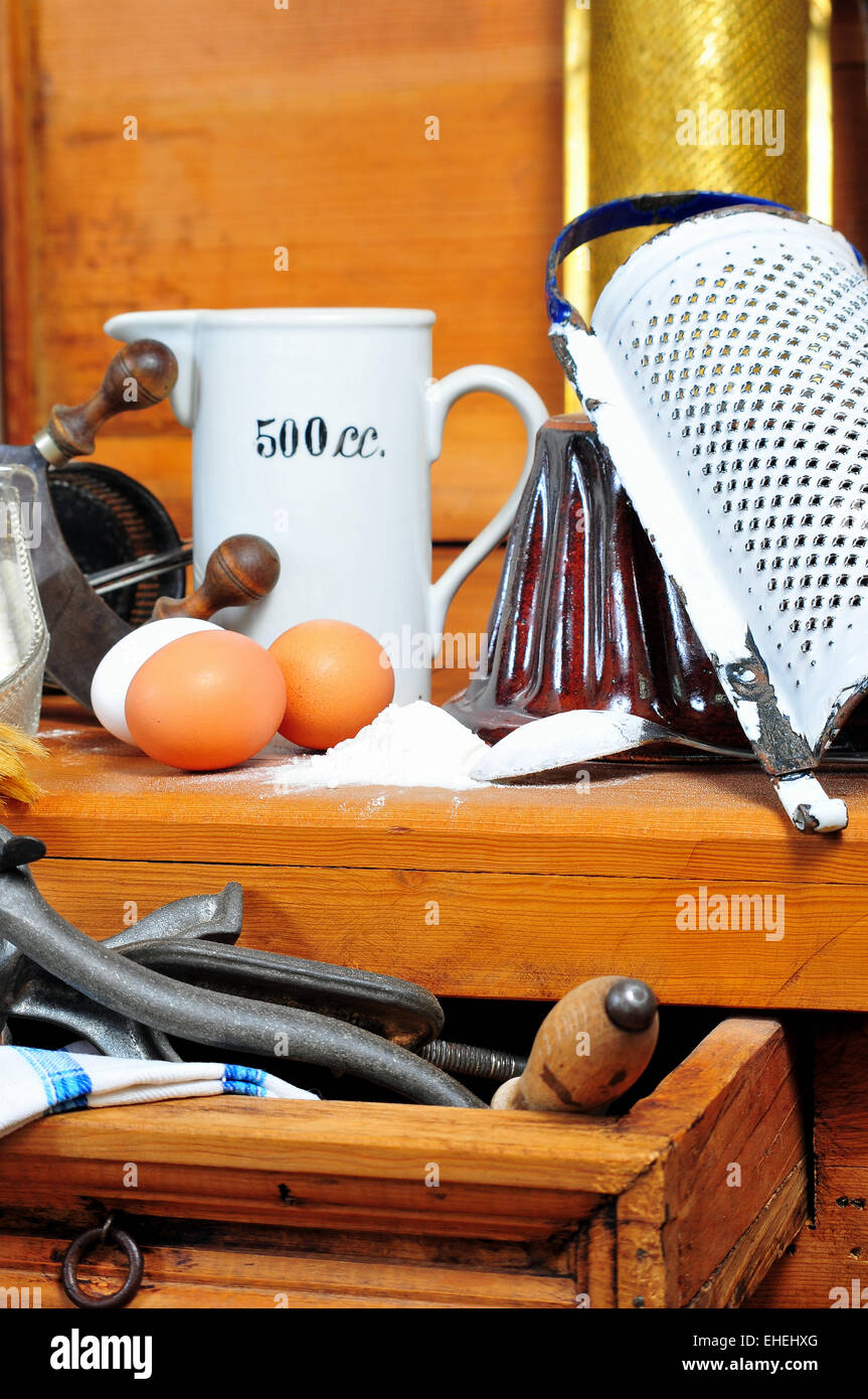 Baking ingredients eggs vintage kitchen - Stock Image