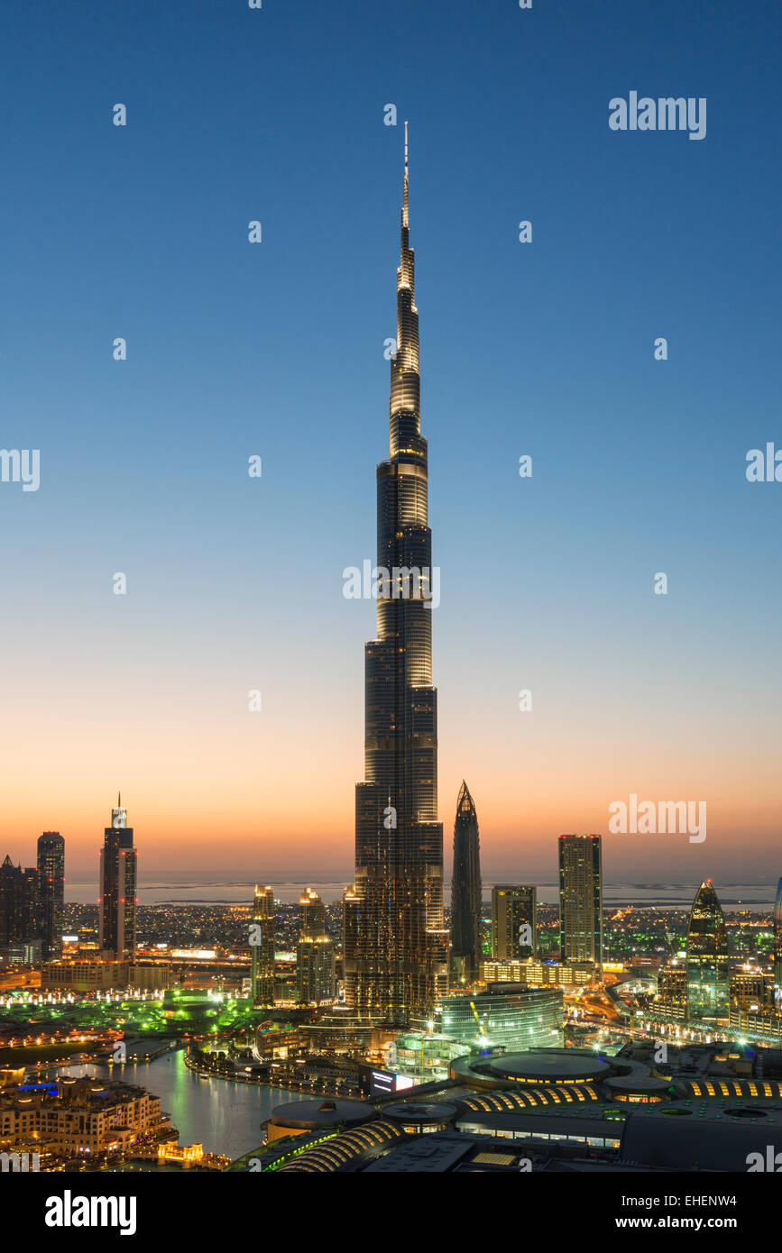 Burj Khalifa and skyline of Downtown Dubai at night in United Arab Emirates - Stock Image