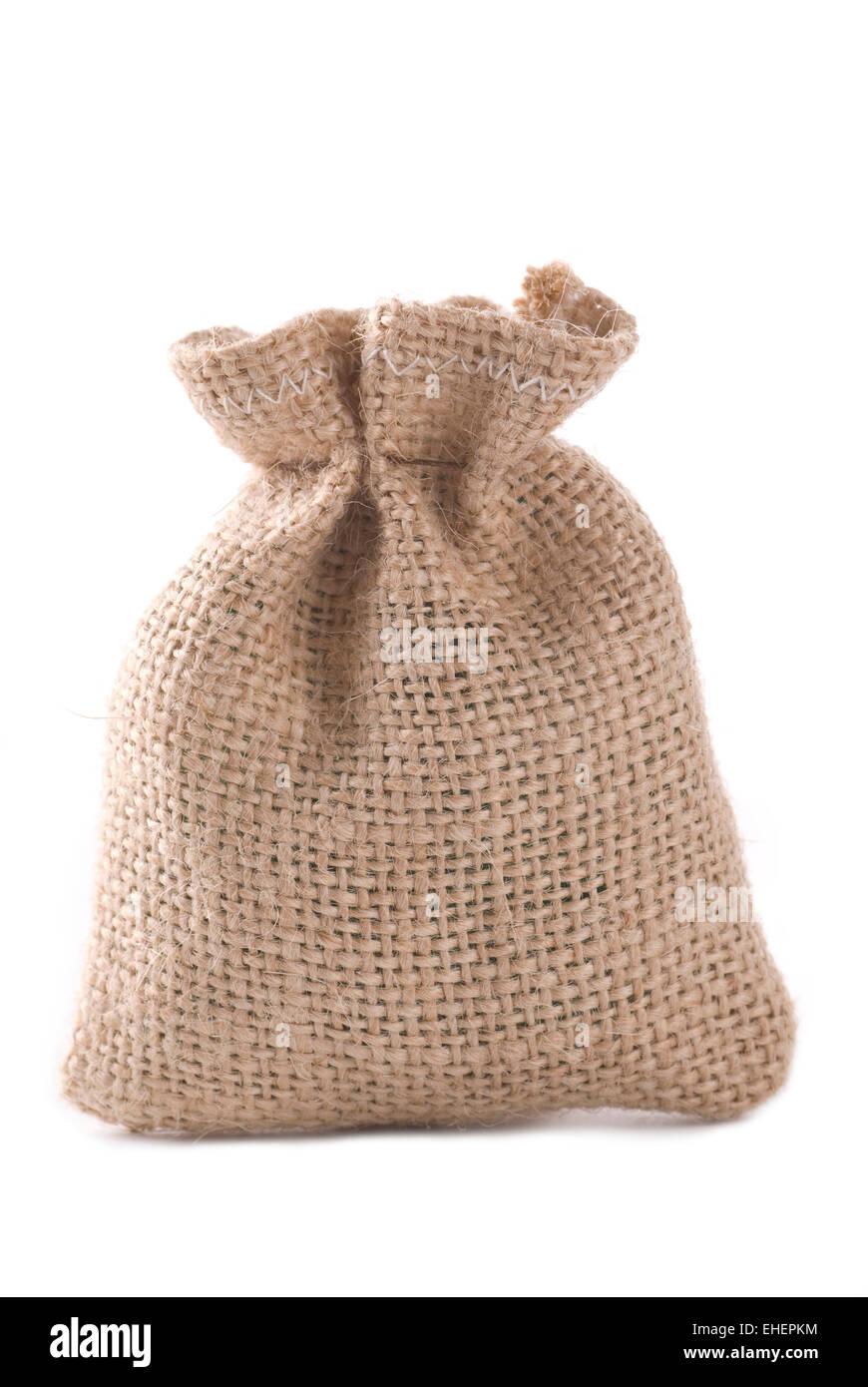 Tied sack made of burlap on white background. - Stock Image