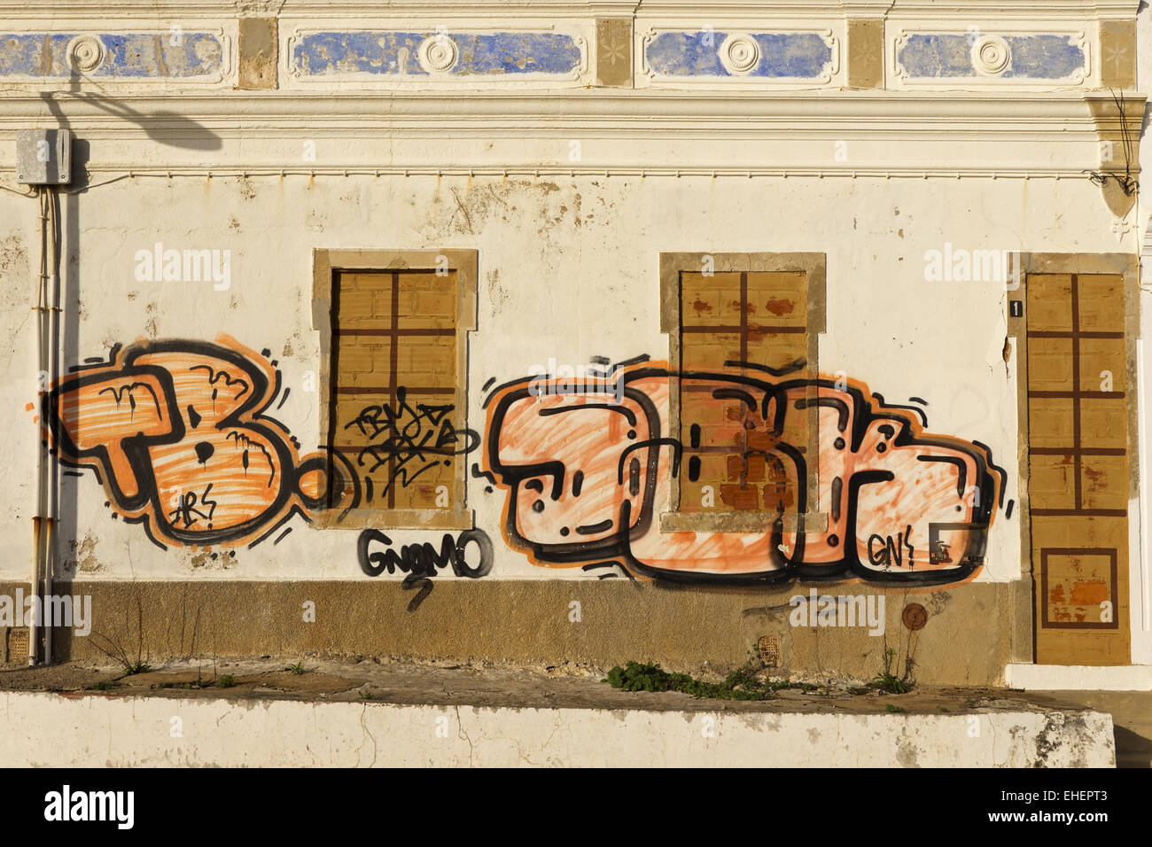 Graffiti on a building facade - Stock Image