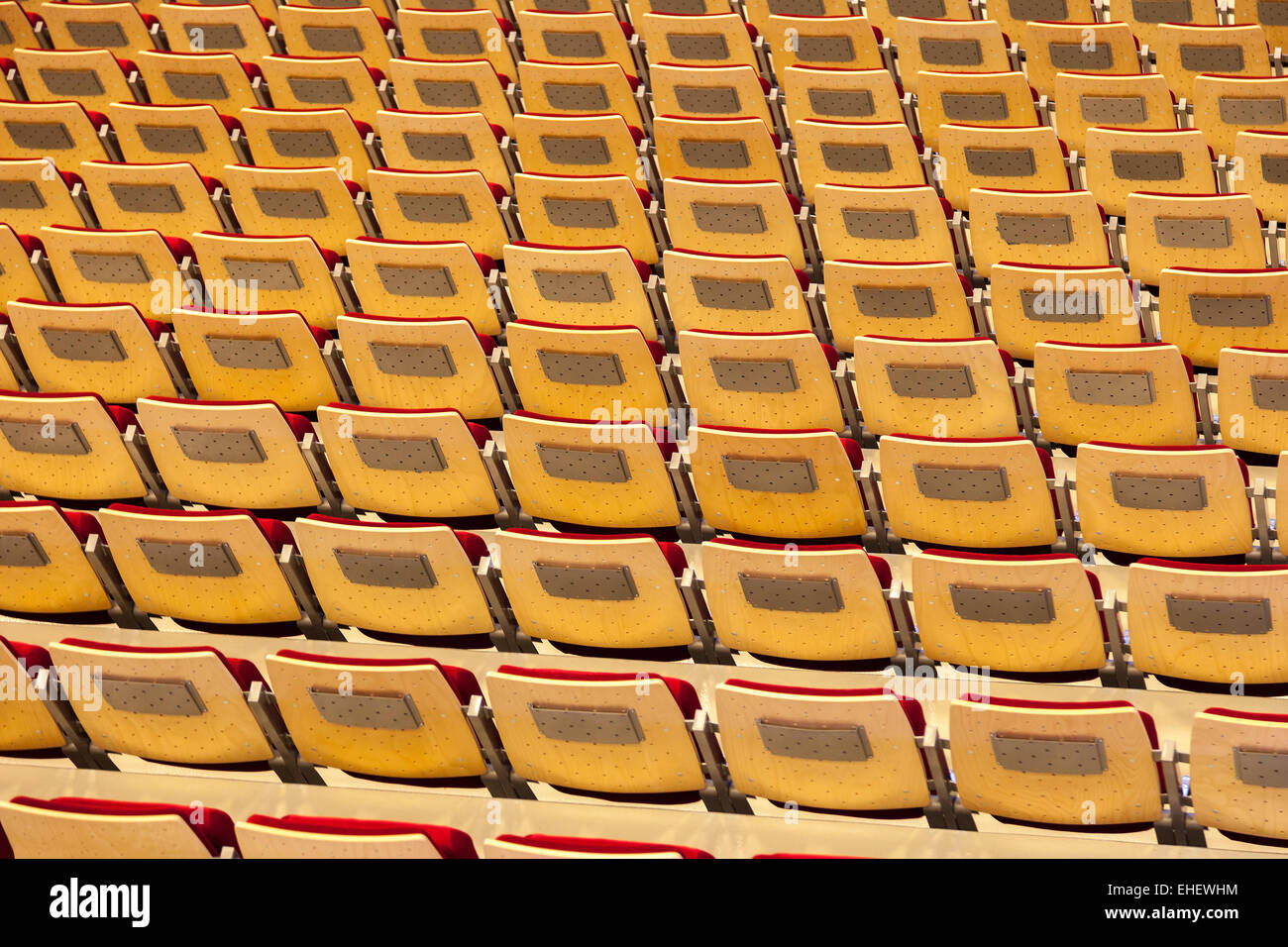 Rows of many seats in a stadium. - Stock Image