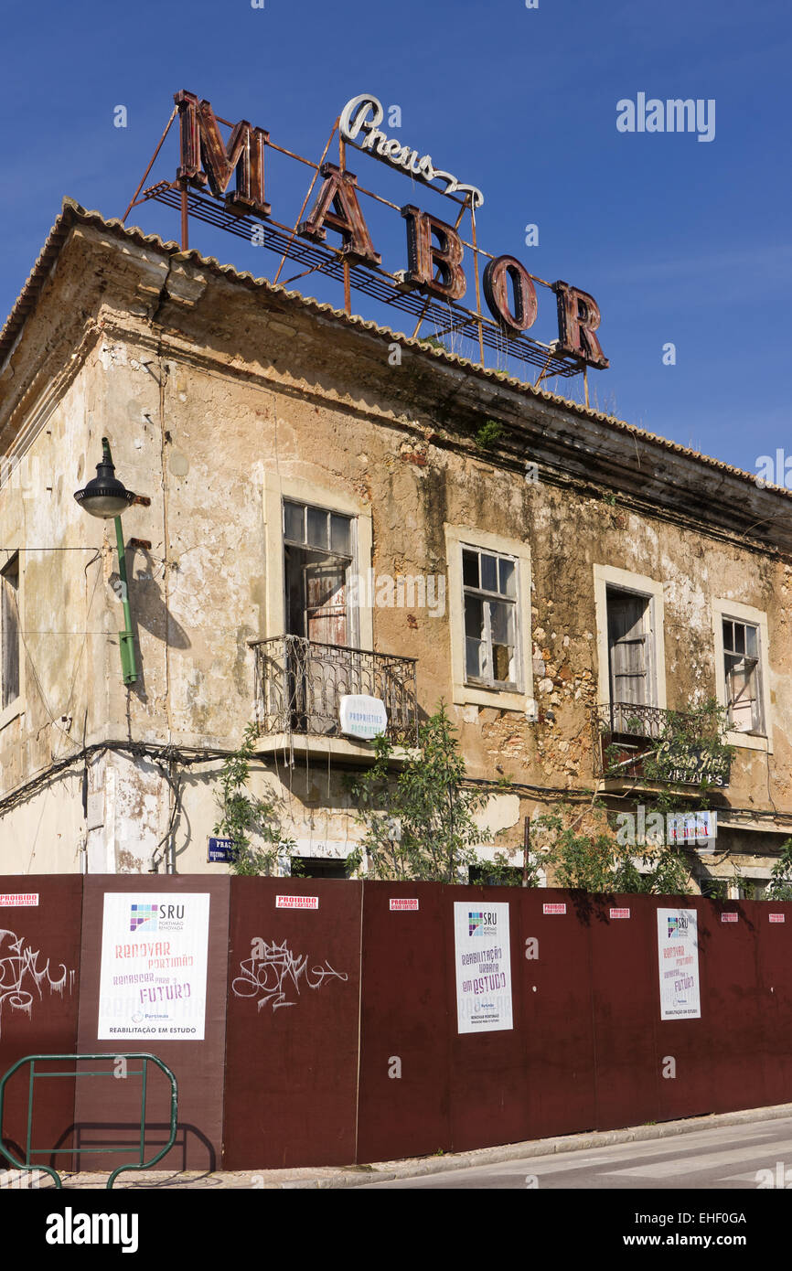 Dilapidated hotel in Portimao - Stock Image