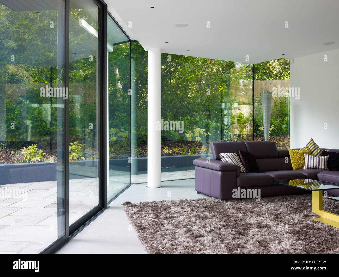 Lounge With Floor To Ceiling Glass Walls, Large Rug And Settee In Cherry  Orchard Home