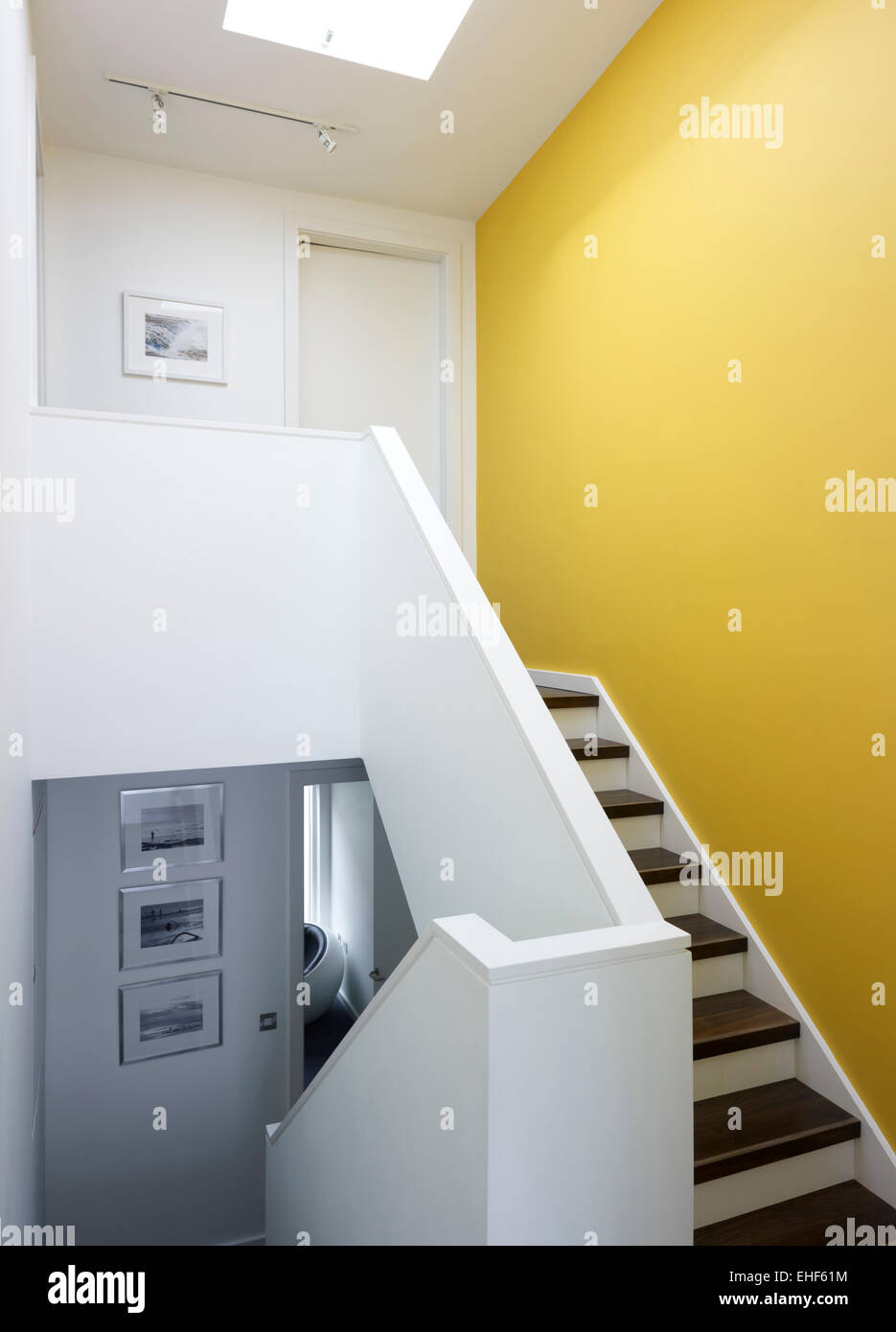Bright yellow hallway and stairs in The Gap House, UK Stock Photo ...