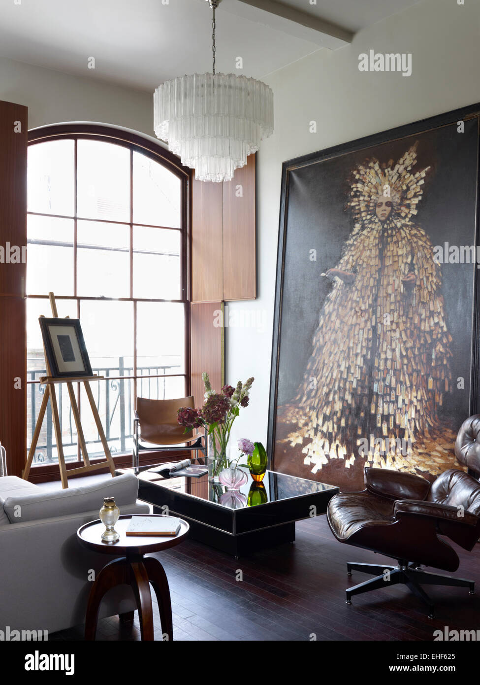 Large artwork in lounge with leather armchair chandelier shutters large artwork in lounge with leather armchair chandelier shutters and wooden floor in kensington court mews home uk aloadofball Image collections