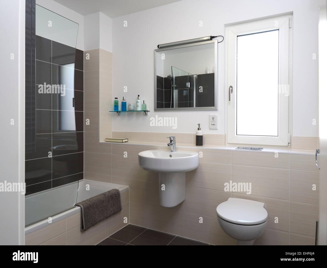 Modern grey tiled bathroom in White Hart House home, UK Stock Photo ...