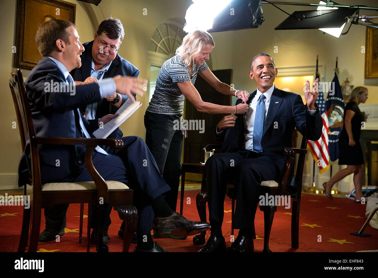 US President Barack Obama laughs as he is miked for an interview with host Chuck Todd of NBC's 'Meet The - Stock Image
