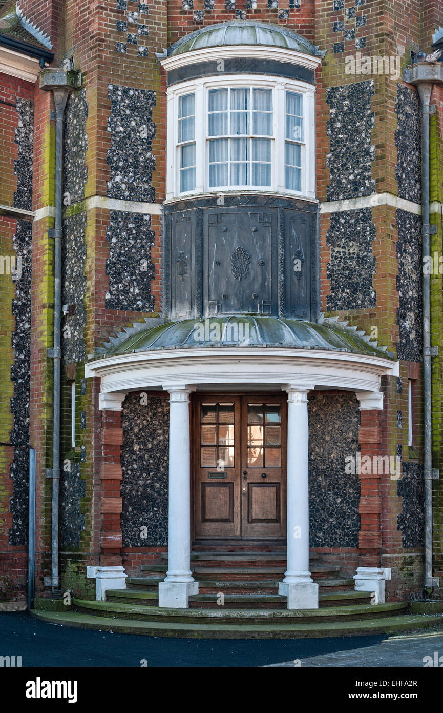 Aldeburgh, Suffolk, UK. Detail of an Edwardian house facade, with fine leadwork and knapped flint and brick walls - Stock Image