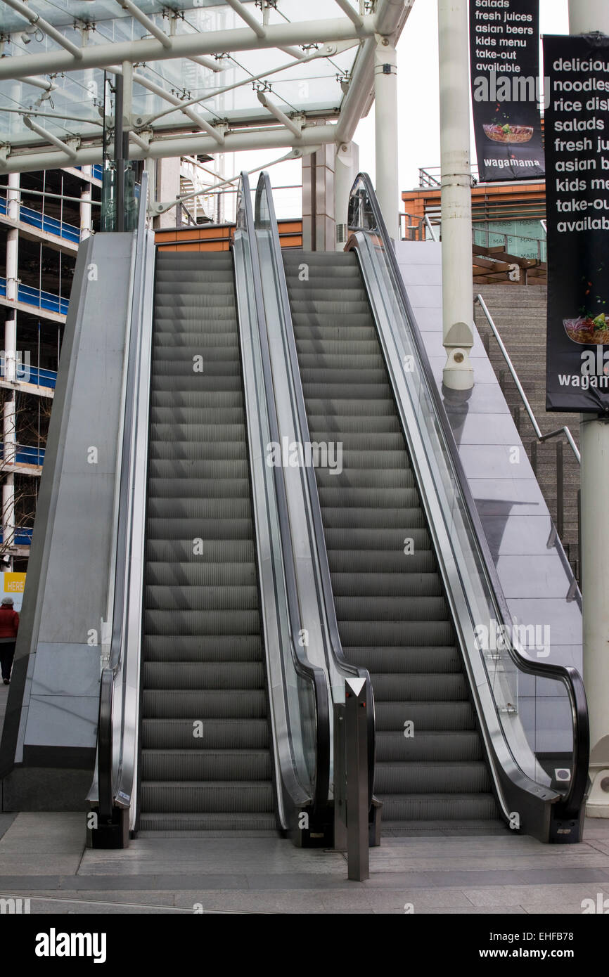 Double escalator in a shopping mall in London England Stock Photo