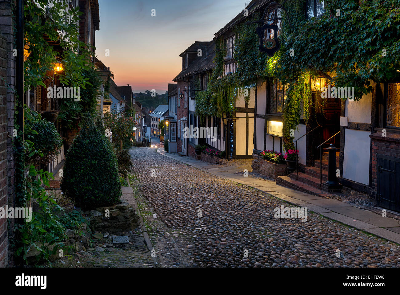 Nighttime on the cobbles at Mermaid Street in East Sussex - Stock Image