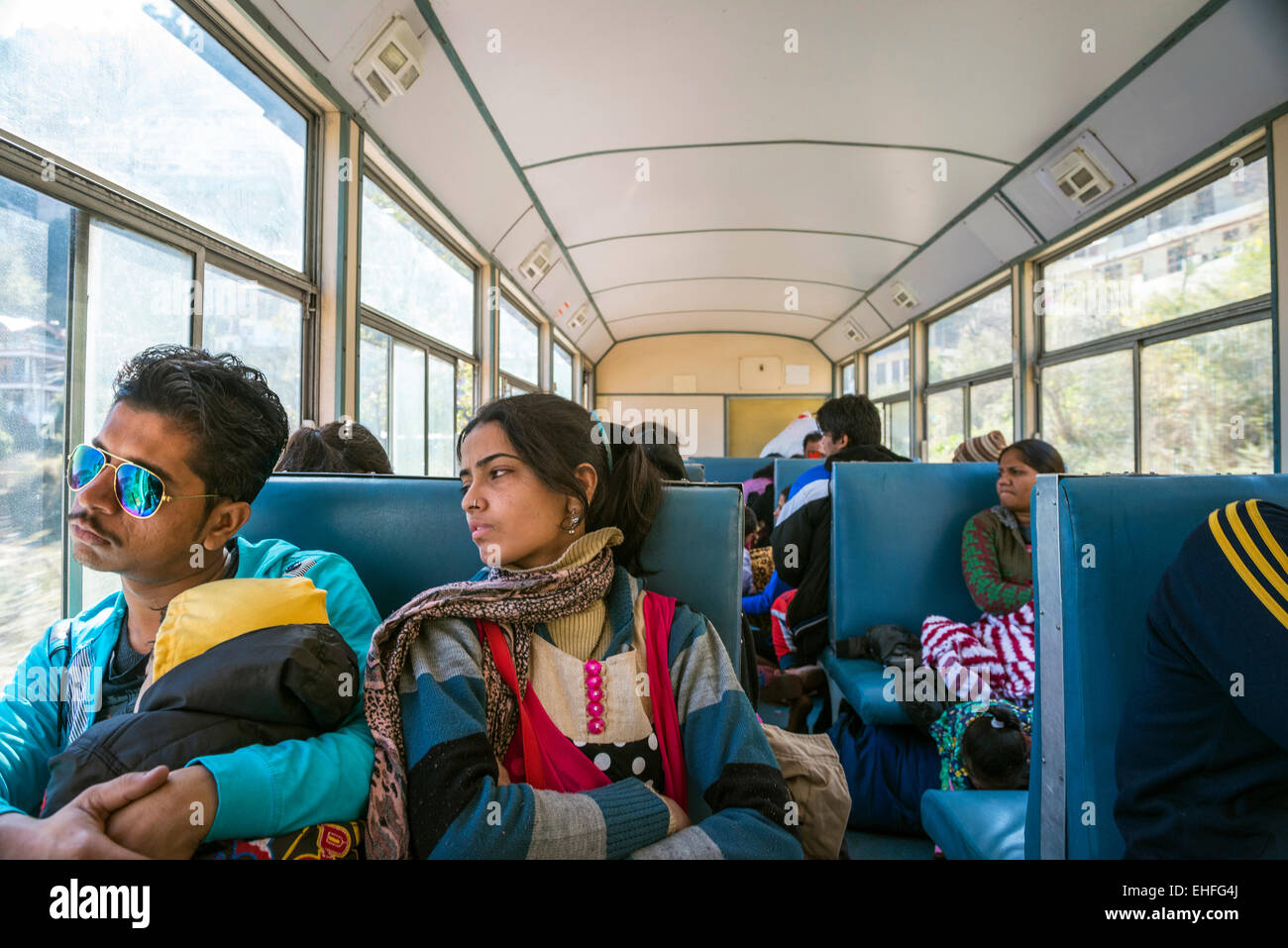 A young Indian couple and child on the Kalka-Shimla Railway, Himachal Pradesh, India - Stock Image