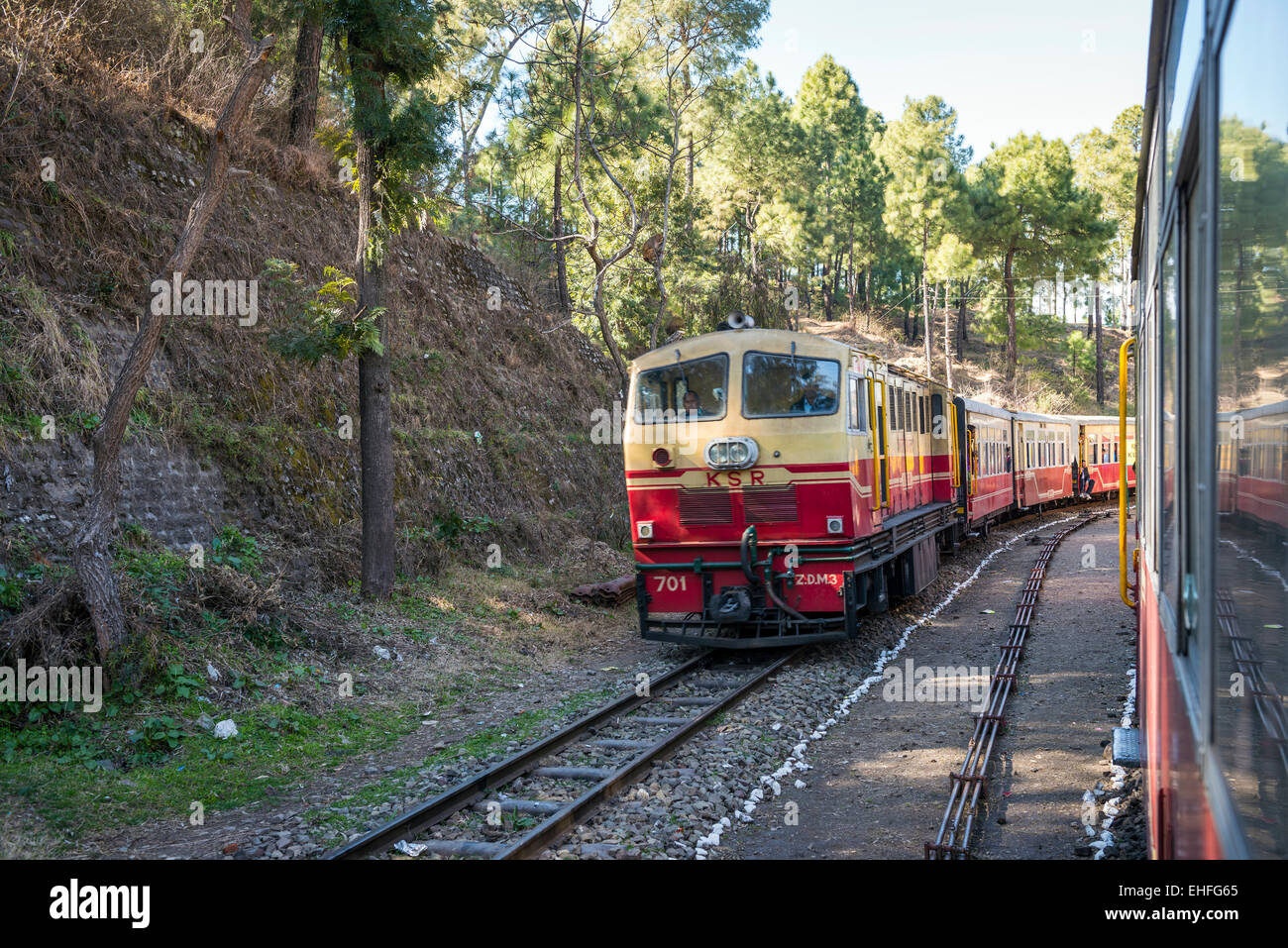 The narrow gauge Kalka-Shimla train winding down through the Himalayan foothills in India - Stock Image