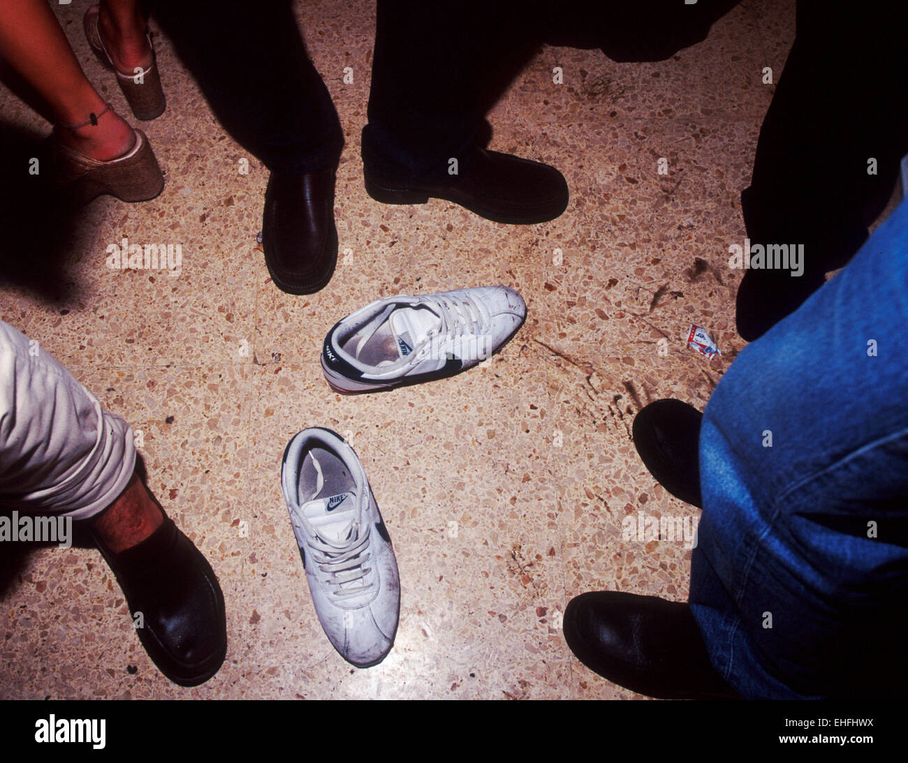 Abandoned trainers on the dancefloor of Es Paradis in Ibiza. - Stock Image