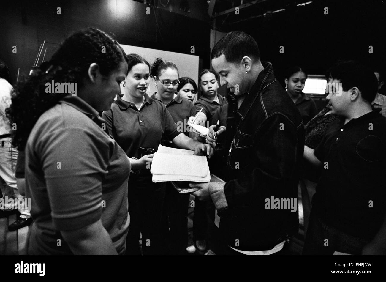 Daddy Yankee signing autographs after a TV appearance in Puerto Rico. - Stock Image