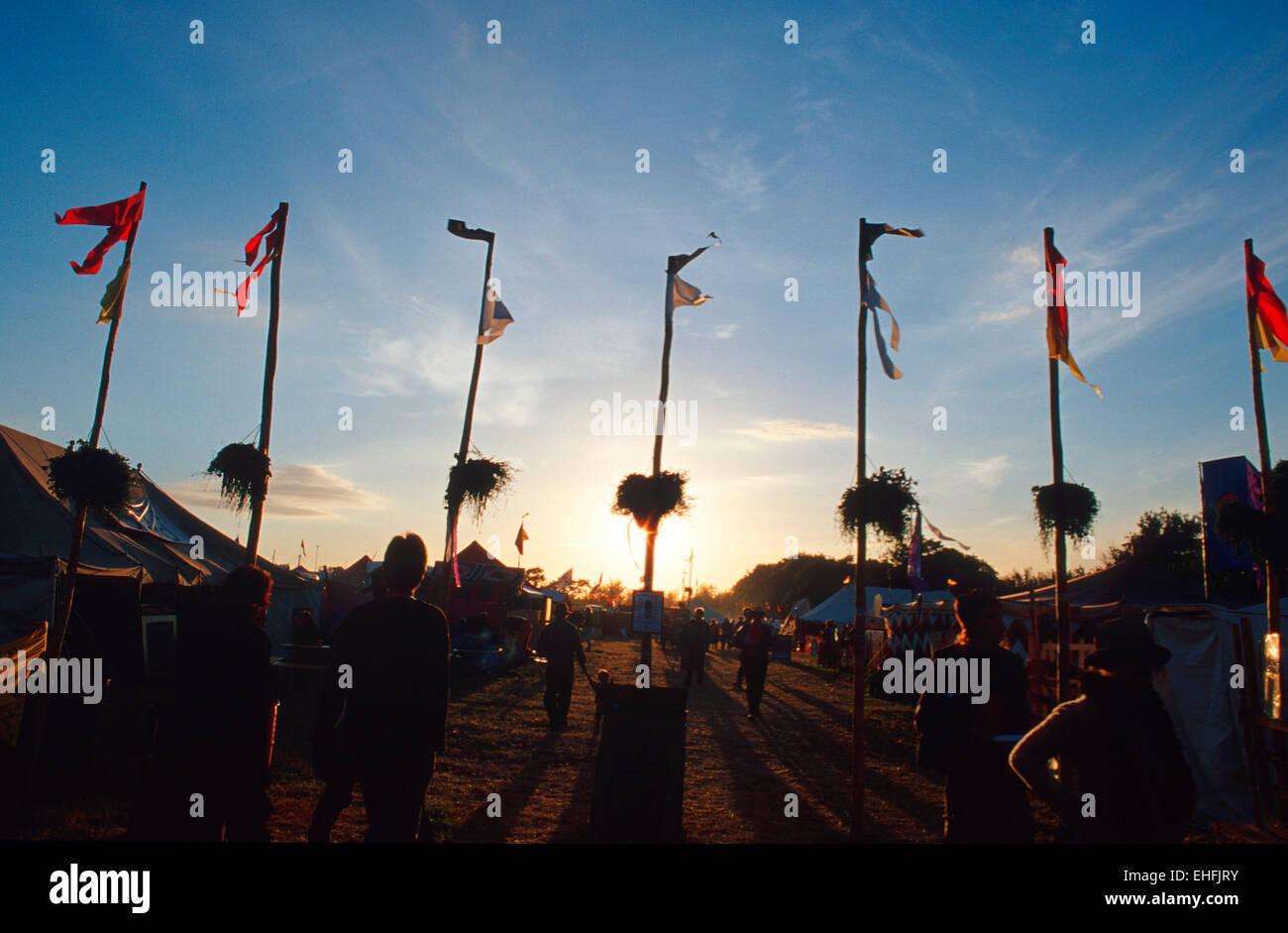 Sundown at the Glastonbury festival. - Stock Image