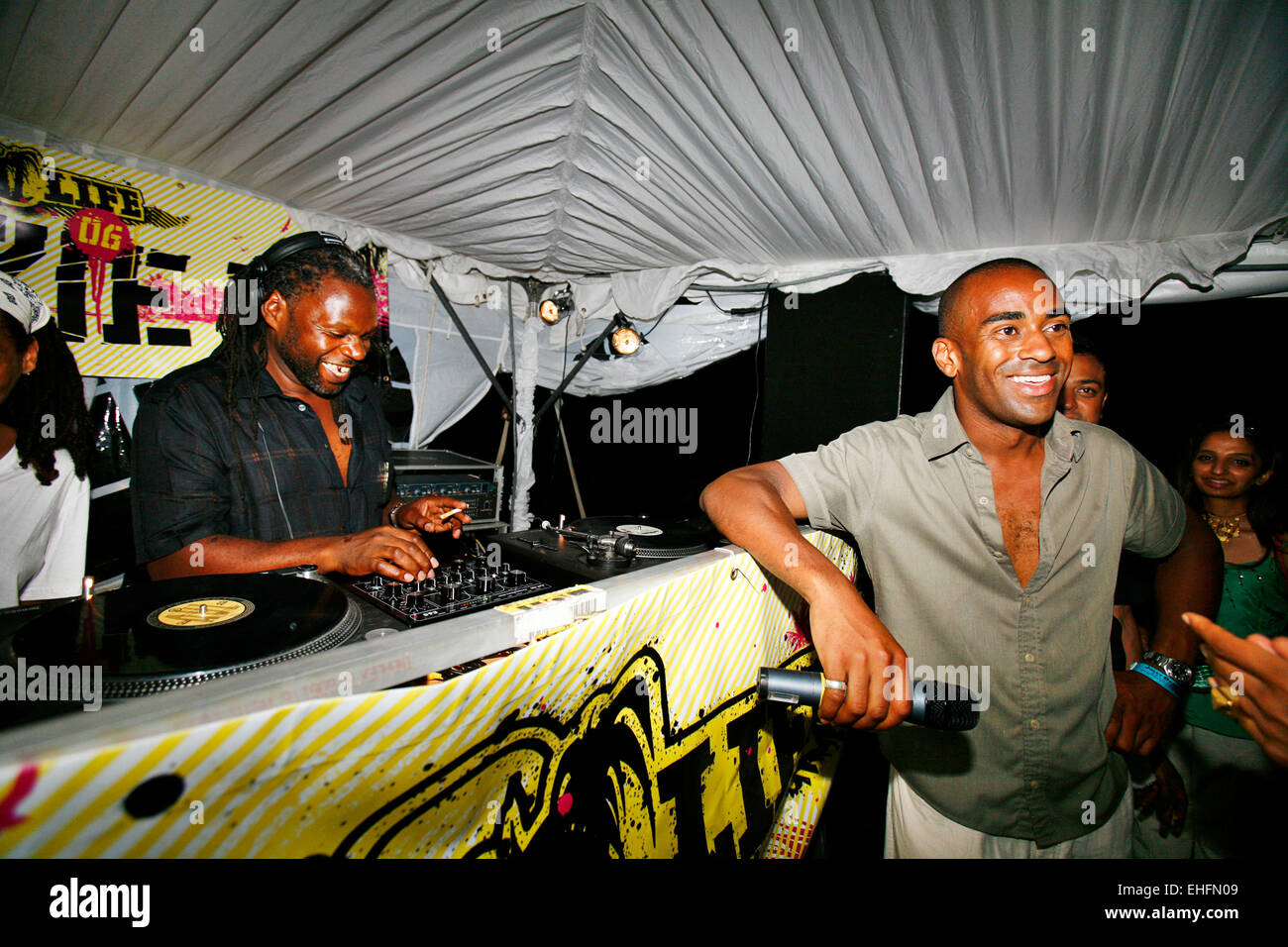 Nigel promoter of Back II Life Antigua with Jazzie B on the decks. - Stock Image
