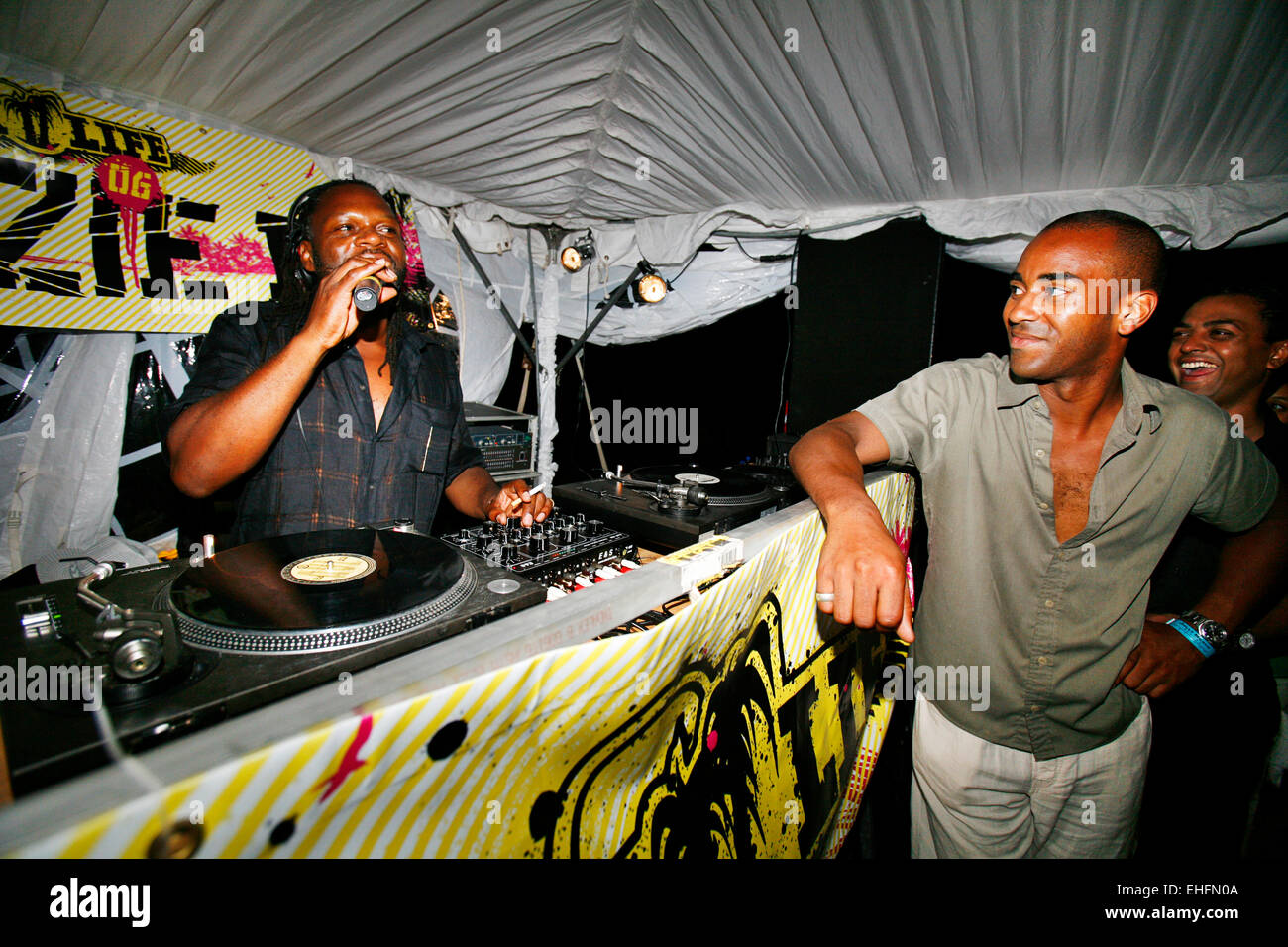 Nigel promoter of Back II Life Antigua with Jazzie B on the mic. - Stock Image