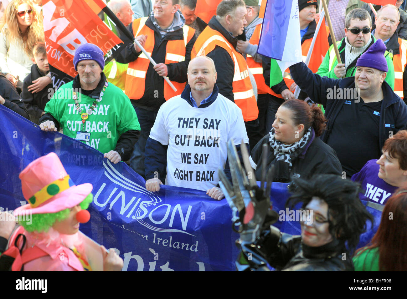 Belfast, UK. 13th March, 2015. A Unison member wearing a 'THey say cut back, we say fight back' T-Shirt - Stock Image