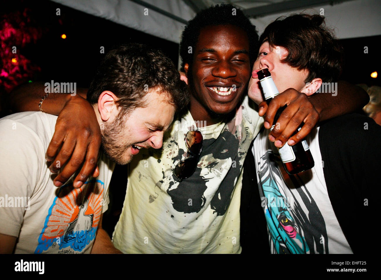 Mates having fun at TDK Cross Central Festival 2007 at Canvas in Kings Cross in London. - Stock Image