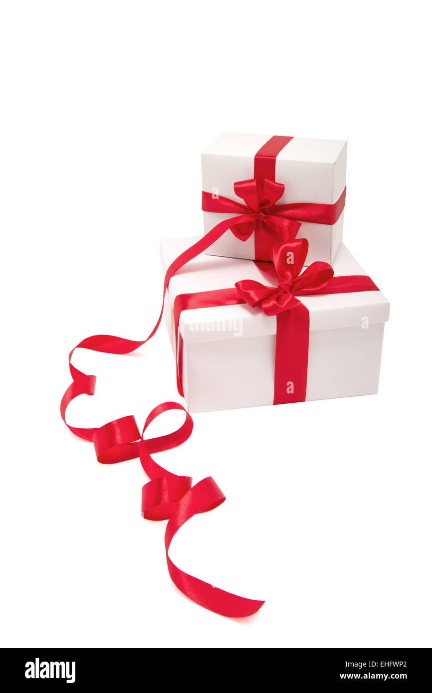 Two white gifts with red ribbons - Stock Image