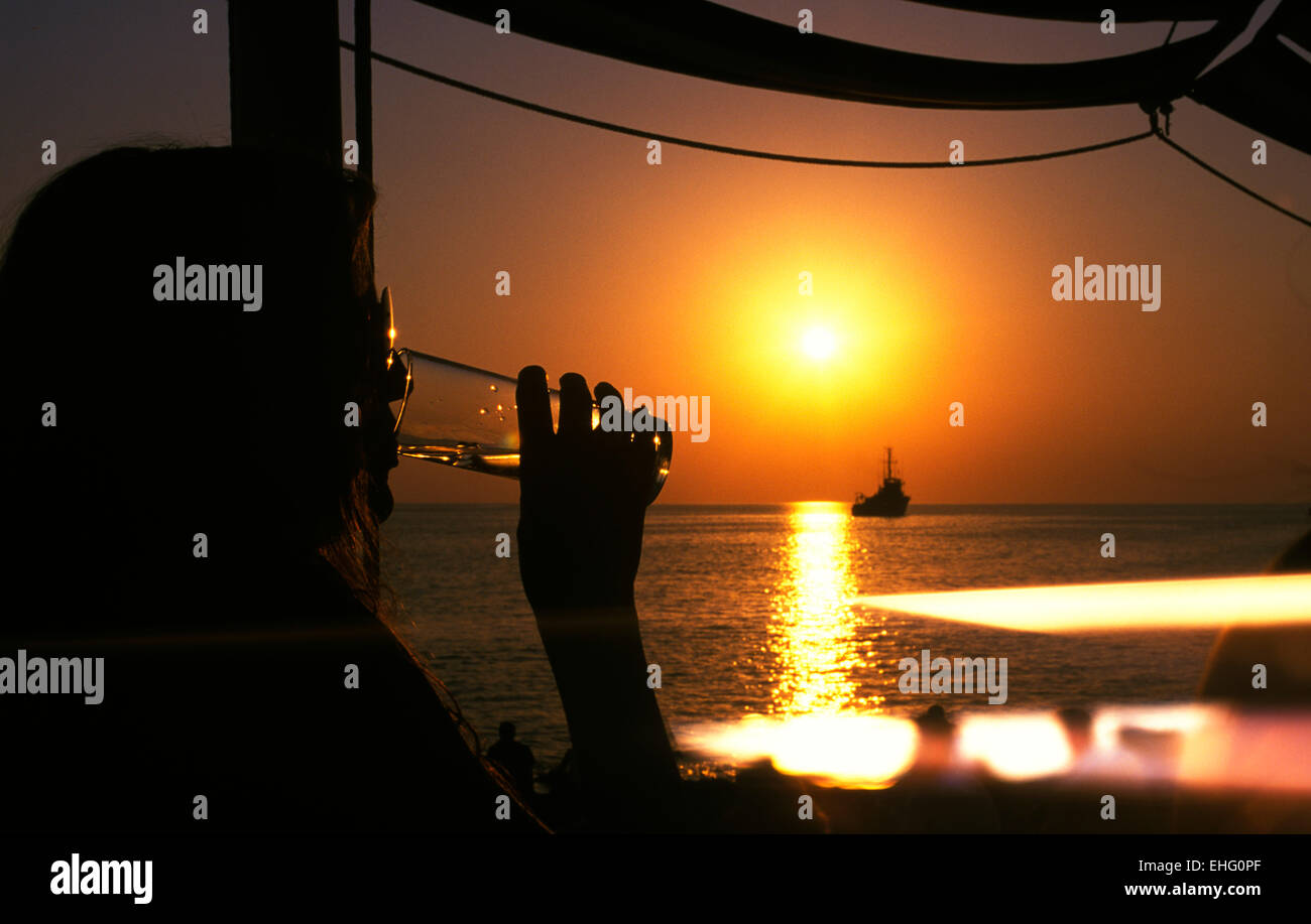 Watching the sunset at Cafe del Mar Ibiza. - Stock Image
