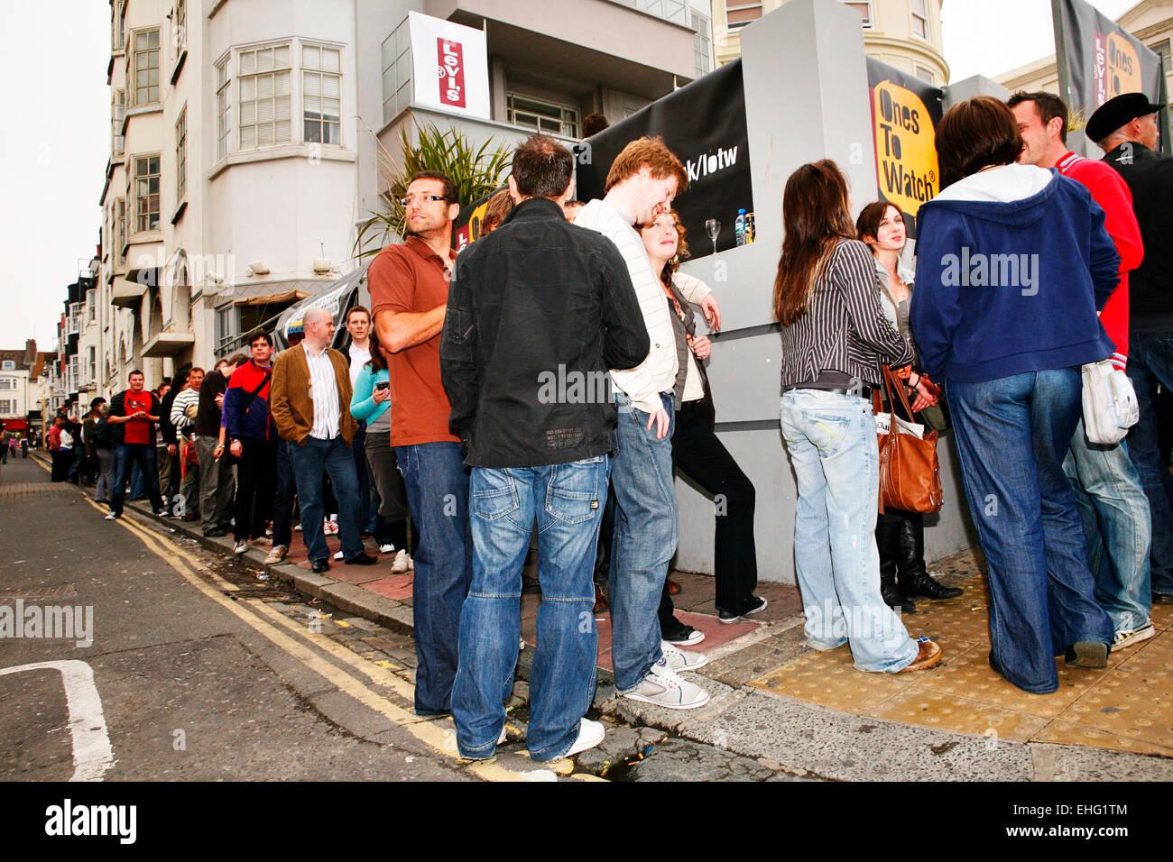Punters queue outside Audio in Brighton. - Stock Image