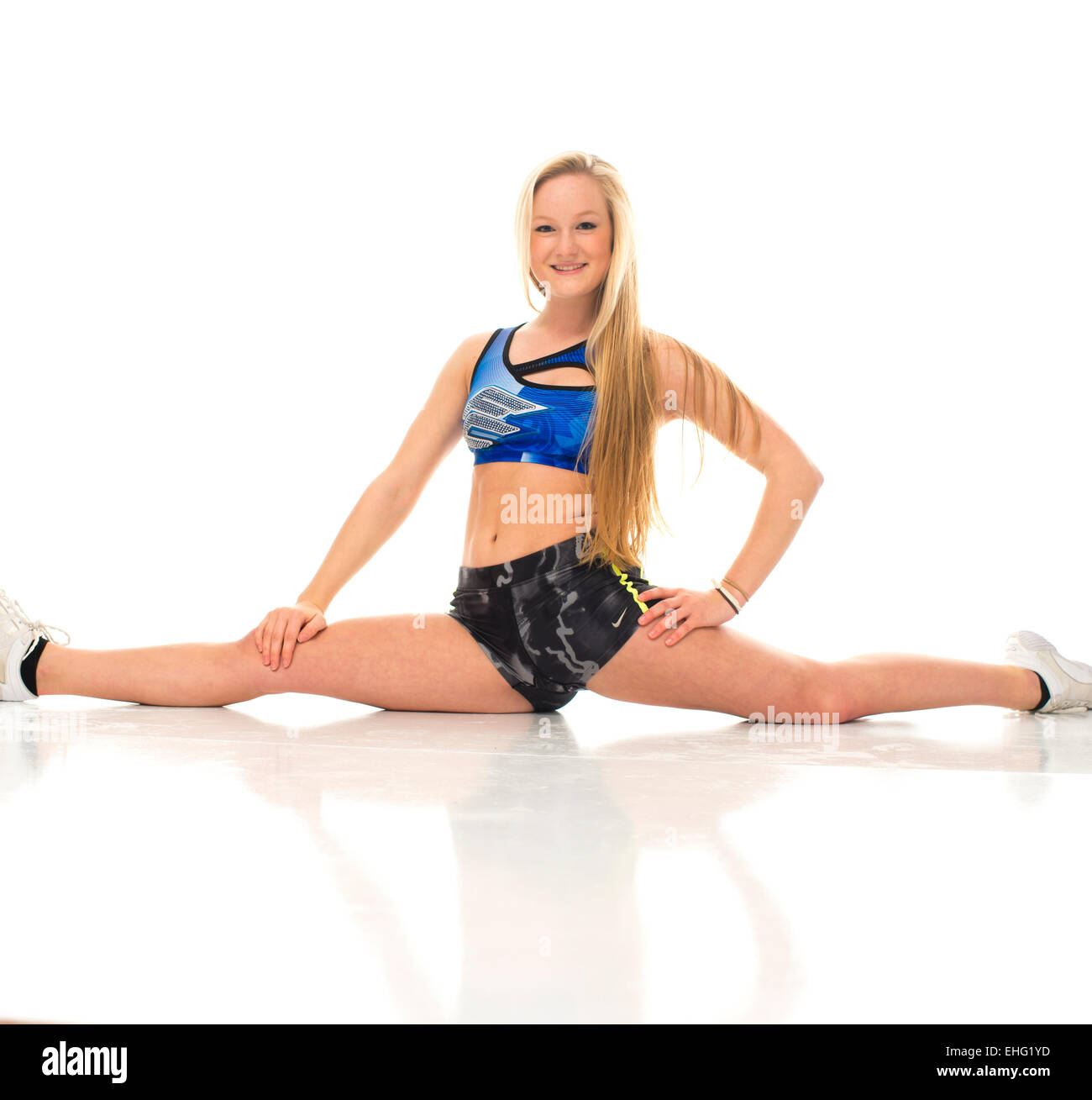 A Young Flexible Stretchy Sporty Fit Woman 19 Year Old Teenage Girl Wearing Sportwear Stretching Exercising Keeping Fit Doing The Splits Uk