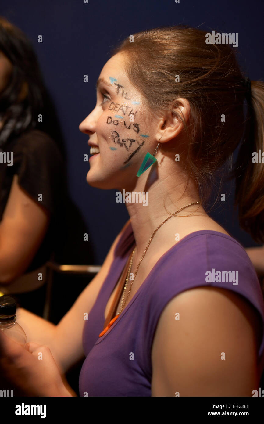 Girl with 'Til death do us party' written on her cheek at The End Closing Party 24th January 2009. - Stock Image