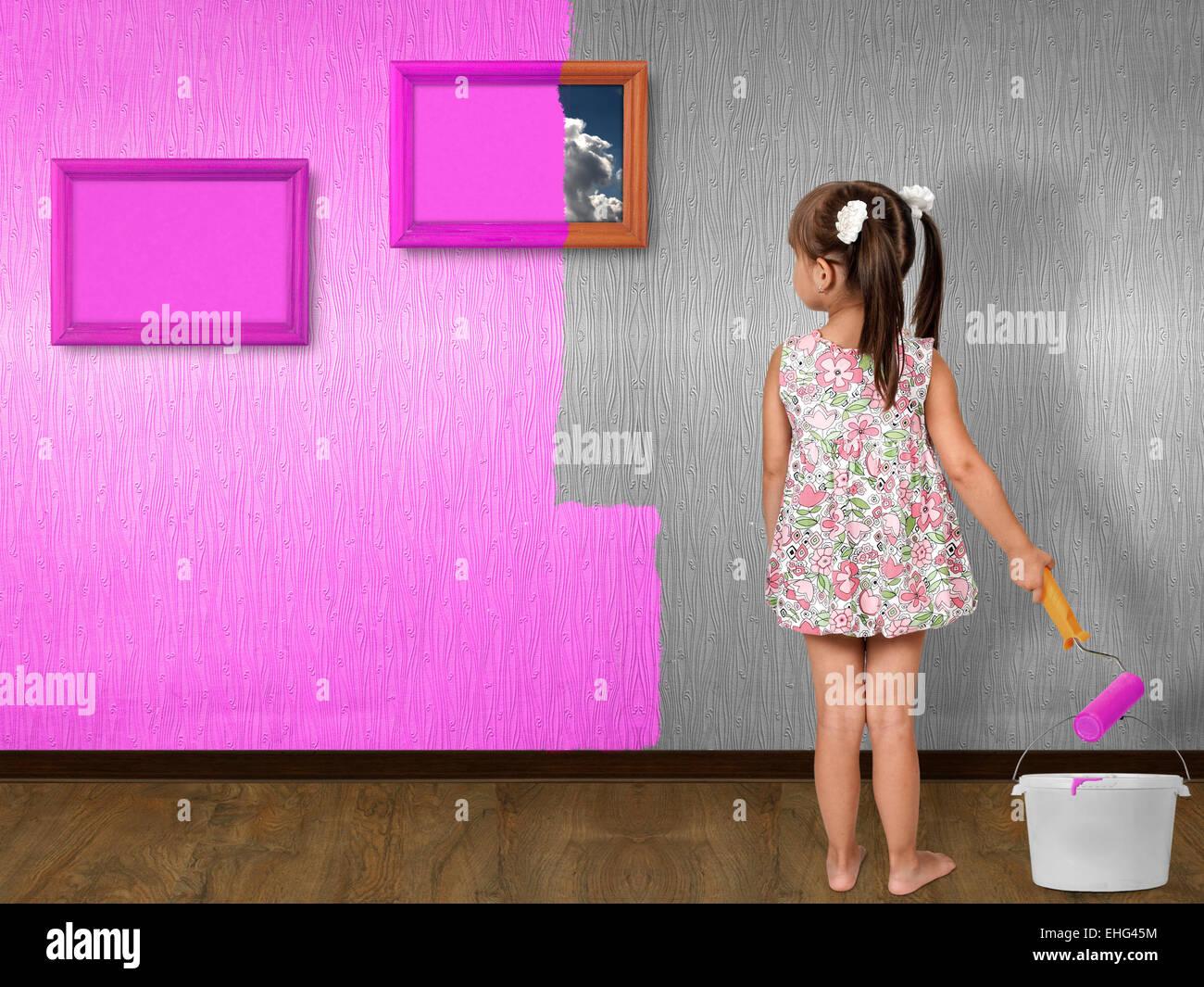 child girl doing repair, painting wall - Stock Image
