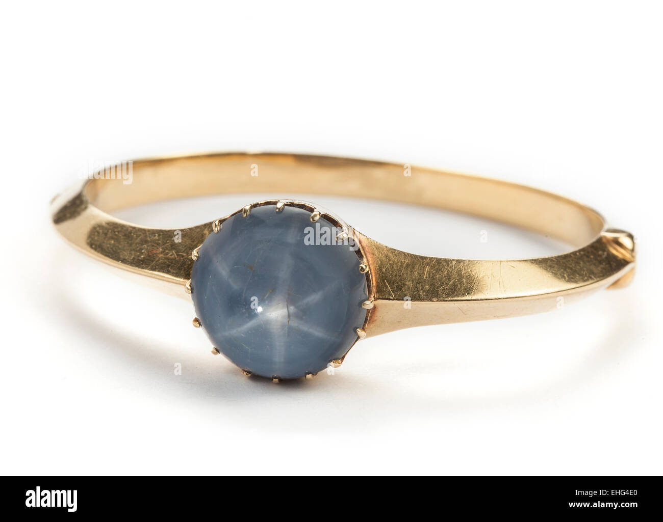 A star sapphire hinged gold bangle. - Stock Image