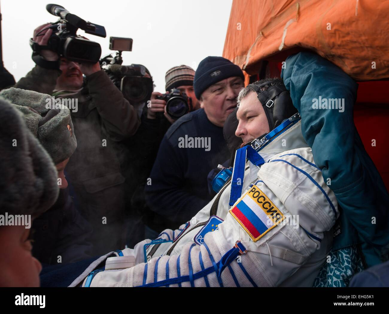 ISS Expedition 42 Cosmonaut Alexander Samokutyaev is carried to the recover vehicle outside the Soyuz TMA-14M  capsule - Stock Image