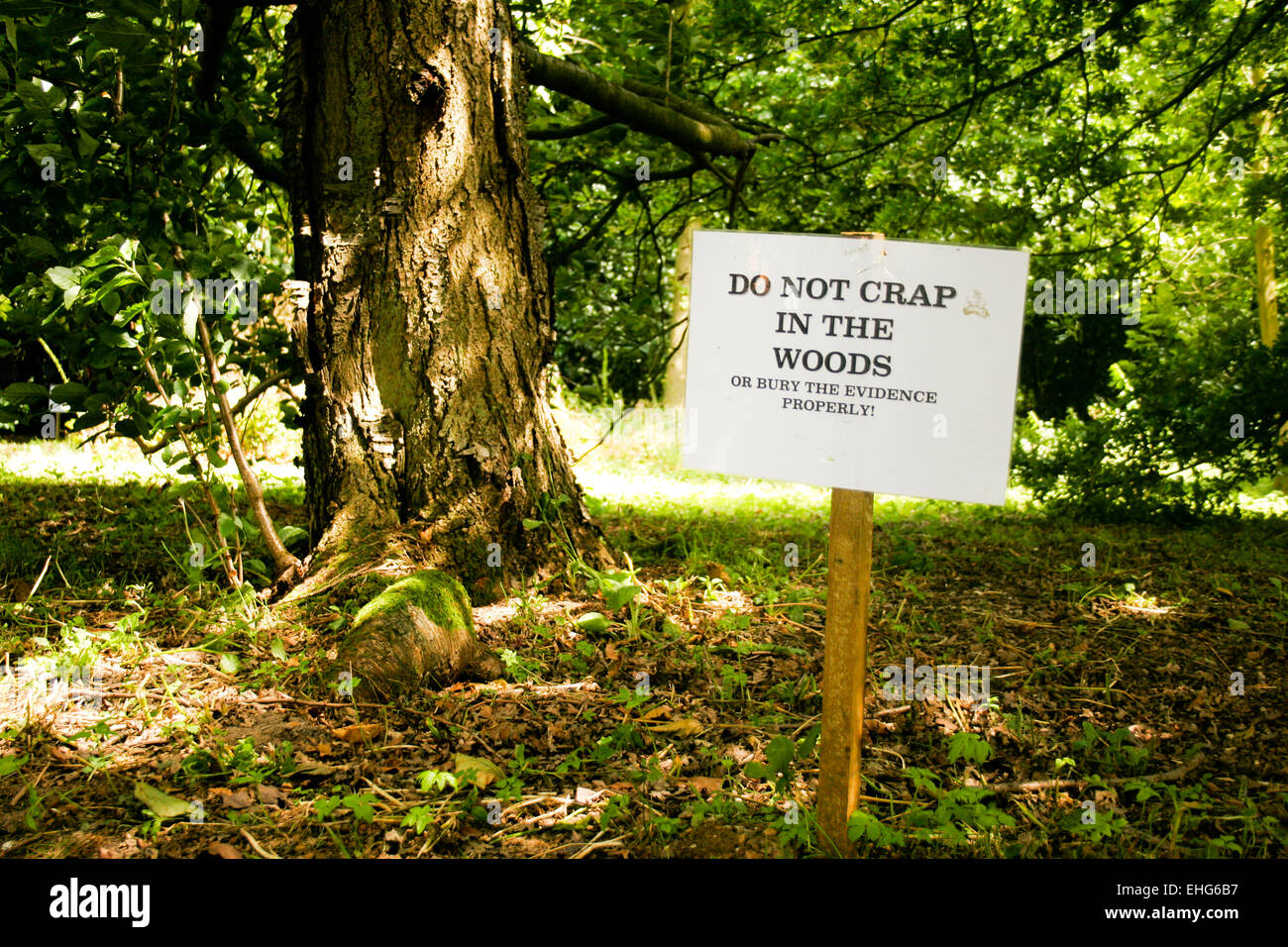 Funny sign in the woods at a festival. Stock Photo