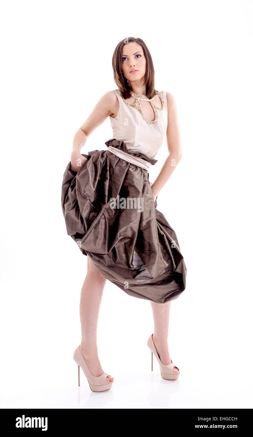 Beautiful woman in a brown dress posing for a photo shoot - Stock Image