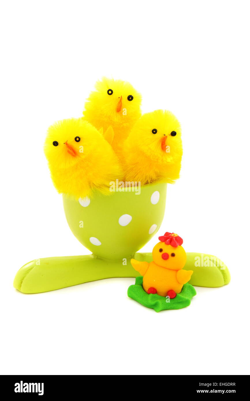 Easter chickens for eggs in the stand. - Stock Image