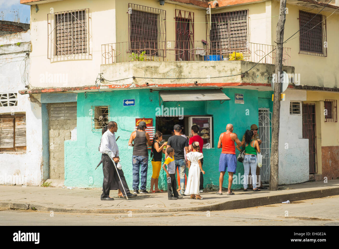 Cuba Santa Clara corner cafe cafeteria snack sandwich bar fast food counter house front room customers eaters diners - Stock Image