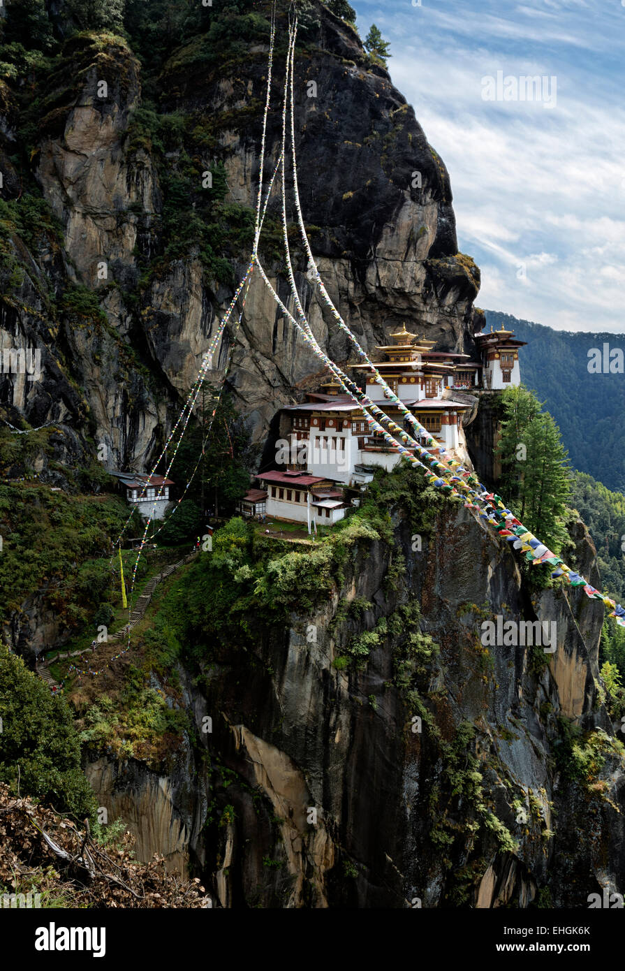 BHUTAN - Prayer flags at Taktshang Goemba, (Tiger's Nest Monastery), perched on the side of a cliff high above - Stock Image