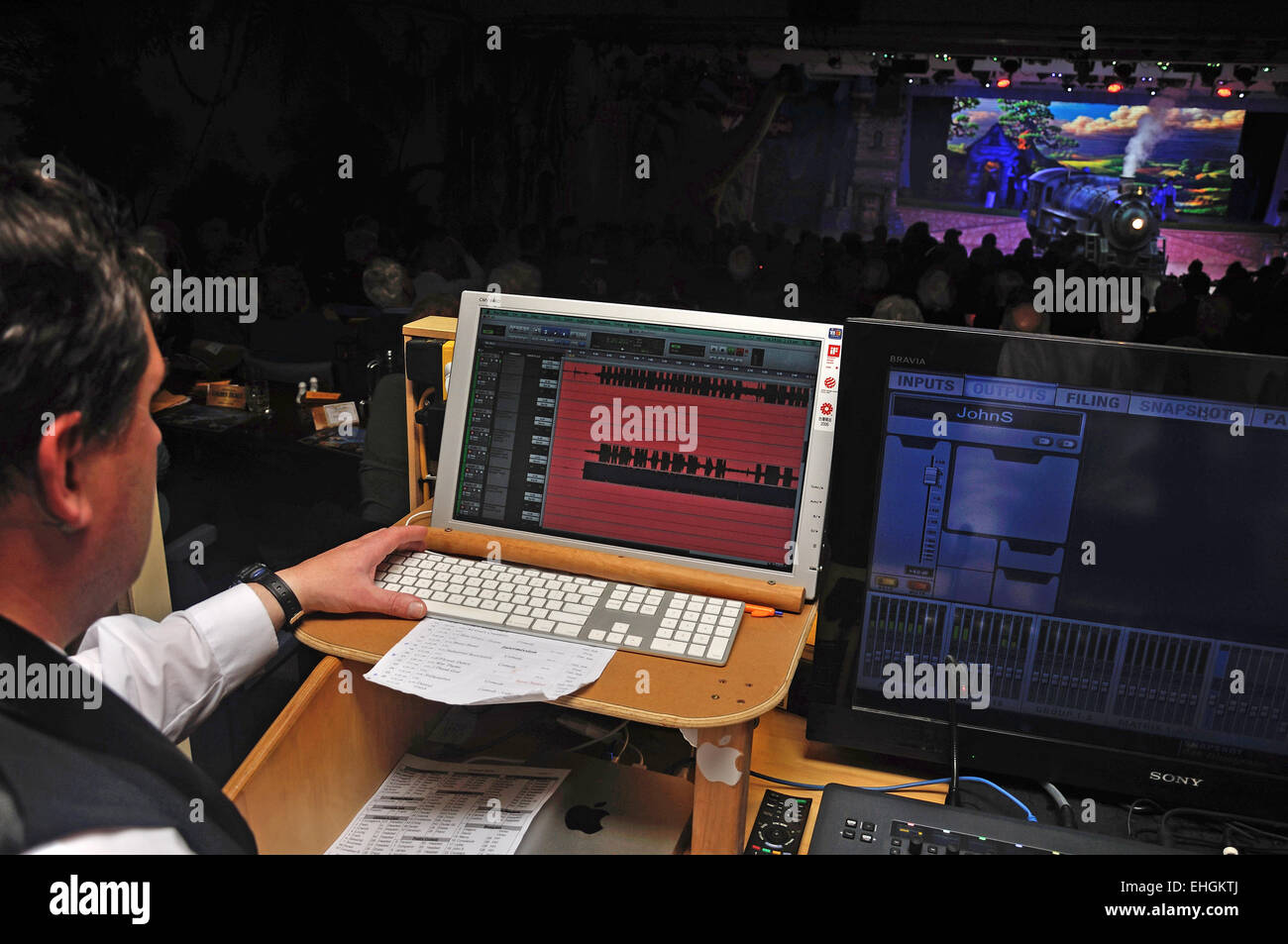 A sound technician adds to the action during a live stage performance - Stock Image